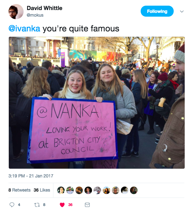 Two young women at the Women's March in London holding up a banner which says @ ivanka we love your work at Brighton Council